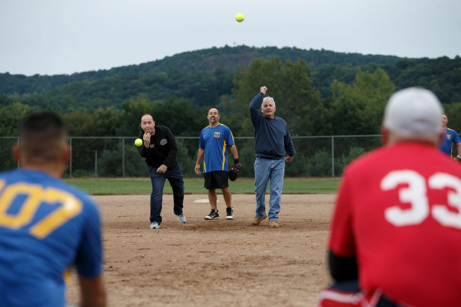 Mayor Kevin Scarpati, left, and  Tom Albanese  throw out the first pitch.