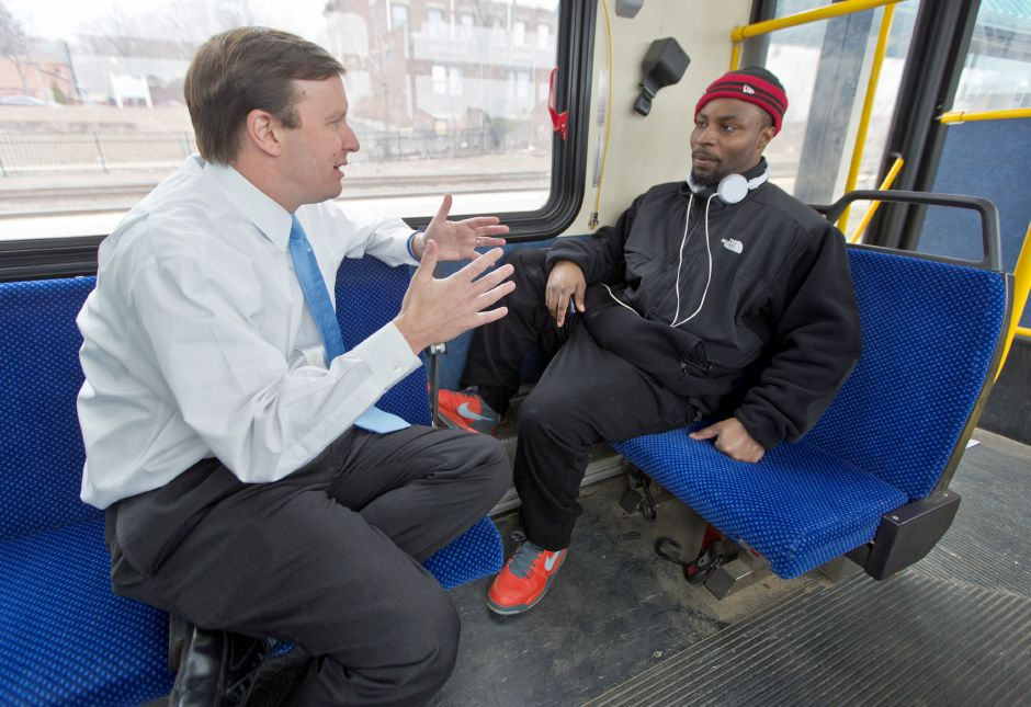 Senator Chris Murphy, left, chats with Michael Ingram of Waterbury, on a local bus in Meriden, Wednesday afternoon, March 19, 2014. Ingram commutes from Waterbury to his job in Wallingford everyday. He and Murphy chatted about minimum wage. | Christopher Zajac / Record-Journal
