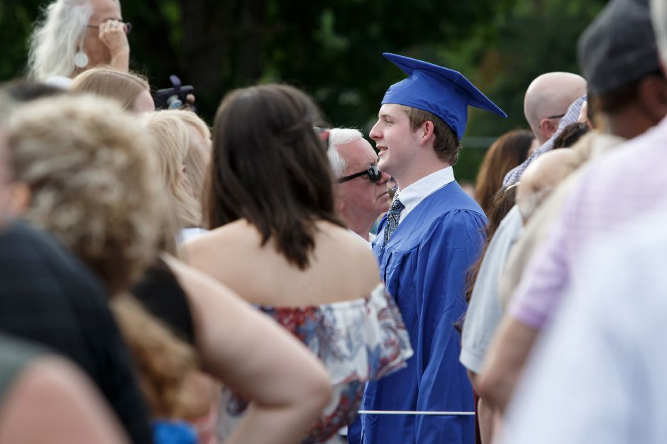 Kevin Ransom makes his way into the ceremony Friday during Lyman Hall High School