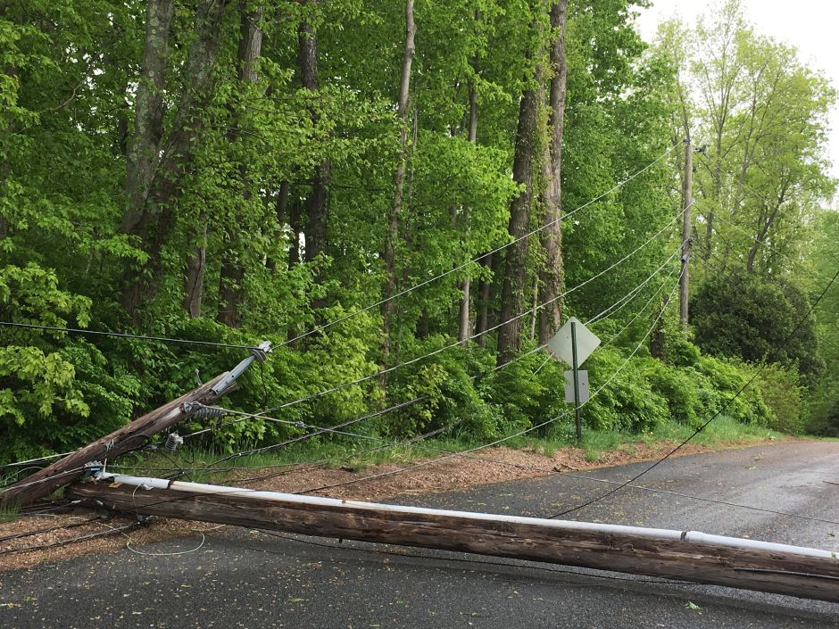 A utility pole knocked down by Tuesday's storm on Creamery Road by Cedar Drive in Durham on Wednesday, May 16, 2018. | Lauren Takores, Record-Journal