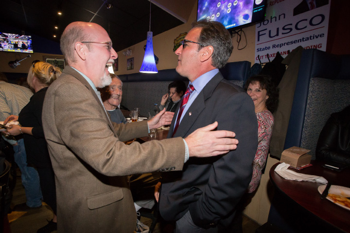 Incumbent Republican 16th Senate District Senator Joe Markley left and Republican challenger 81st House District John Fusco congratulate each other Tuesday at the Republican headquarters at Friends Cafe in Southington Nov. 8, 2016 | Justin Weekes / For the Record-Journal