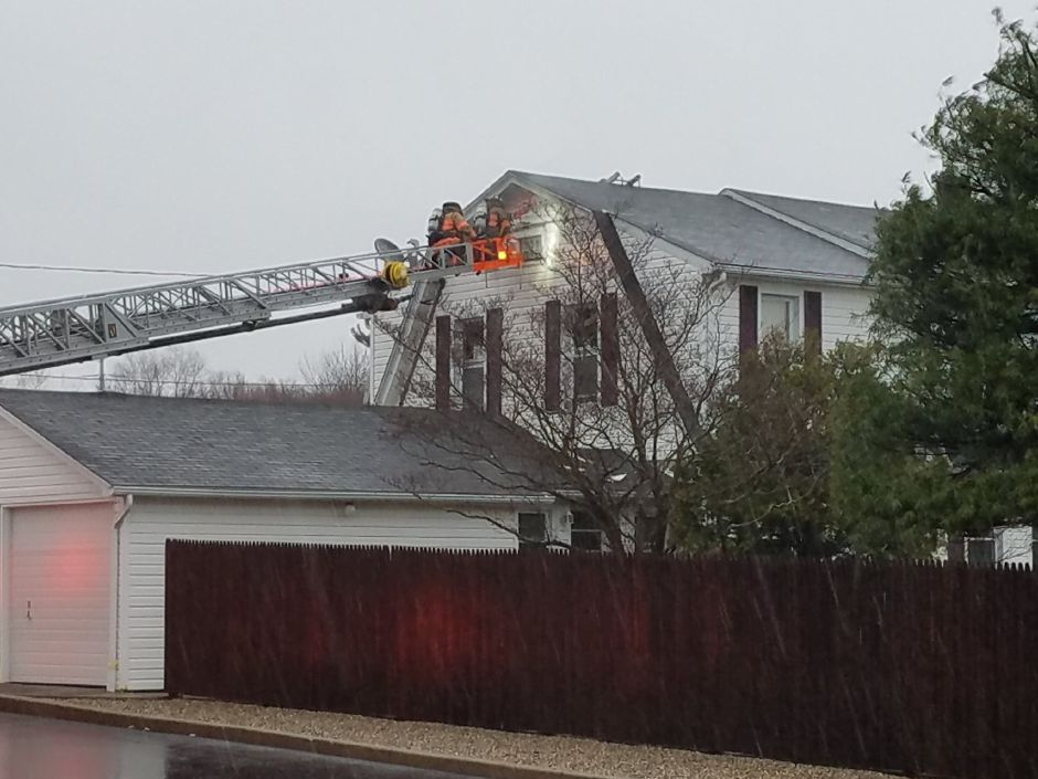 Emergency crews are responding to a reported fire at a Route 5 home in Wallingford. | Lauren Sellew, Record-Journal