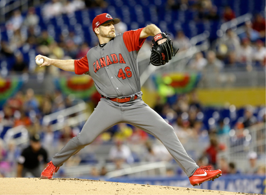 Canada pitcher Ryan Dempster pitches against the United States in a first-round game of the World Baseball Classic, Sunday, March 12, 2017, in Miami. (AP Photo/Alan Diaz)