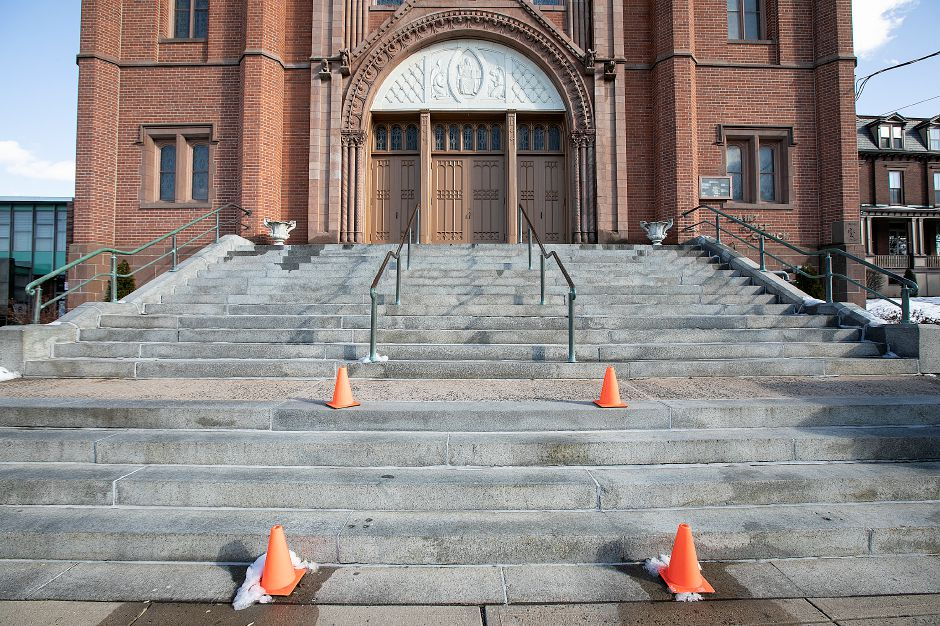 Cones placed where sections of bronze railing were taken in front of Saint Rose of Lima Parish on Center Street in Meriden, Thurs., Feb. 21, 2019. Dave Zajac, Record-Journal