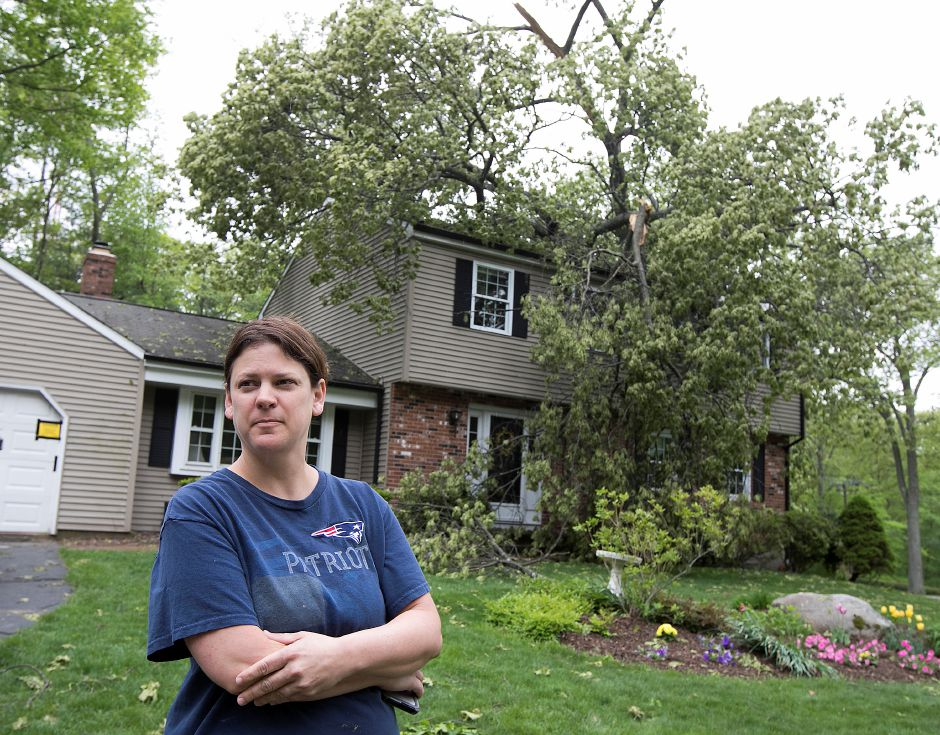 Heather Meyerjack, of 125 Bellamy Rd., Cheshire, stands in front of her home heavily damaged by a fallen tree during Tuesday's severe thunderstorm, Wednesday, May 16, 2018. Dave Zajac, Record-Journal