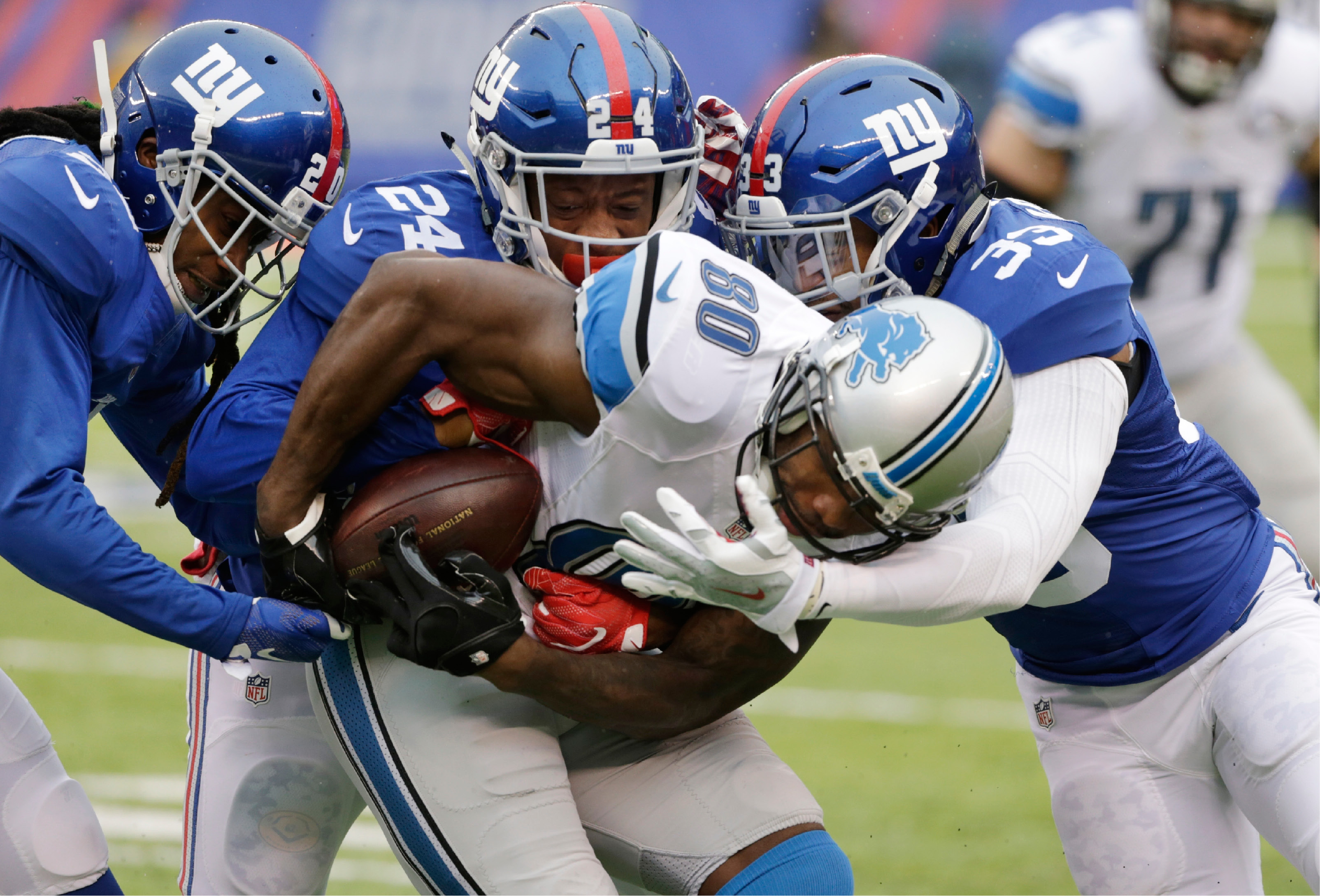 Lions wide receiver Anquan Boldin (80) is tackled by the Giants' Janoris Jenkins, left, Eli Apple (24) and Andrew Adams (33) during the first half of Sunday's game in East Rutherford, N.J. | Associated Press