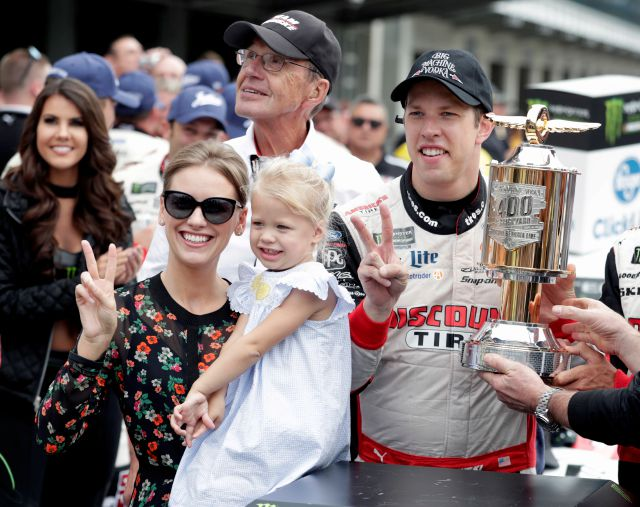 NASCAR Cup Series driver Brad Keselowski (2) celebrates with his wife Paige and daughter Scarlett after winning the NASCAR Brickyard 400 auto race at Indianapolis Motor Speedway, in Indianapolis Monday, Sept. 10, 2018. (AP Photo/Michael Conroy)