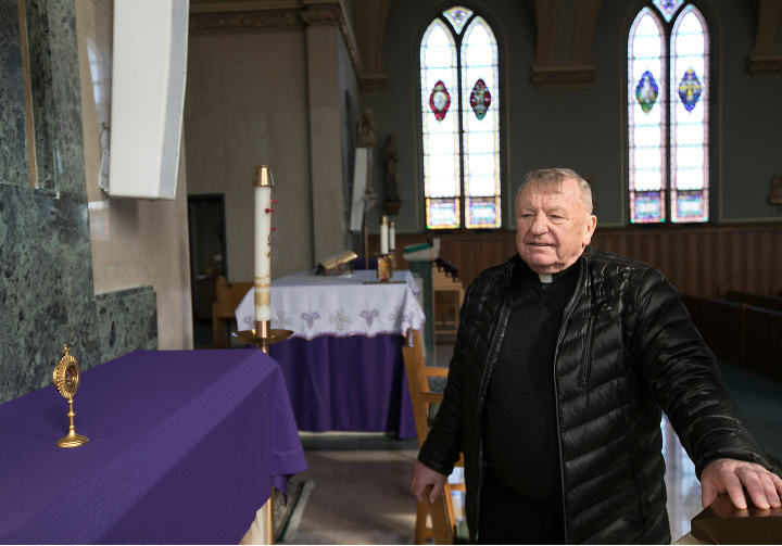 Rev. Adam Subocz, pastor of Immaculate Conception Church in Southington, looks over a relic of St. Faustina Kowalska in the church sanctuary, Thursday, March 9, 2017.  | Dave Zajac, Record-Journal