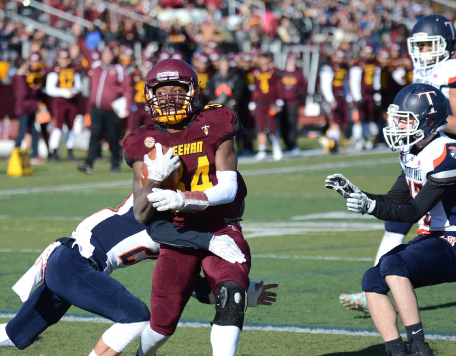 Terrence Bogan, of Sheehan, runs in the team's annual Thanksgiving Day football game against Lyman Hall on Thursday, Nov. 23, 2017. The Titans defeated the Trojans, 49-20. | Bryan Lipiner, Record-Journal