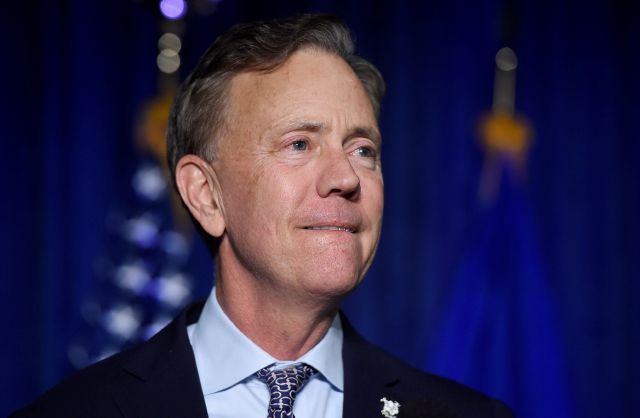FILE - In this Wednesday, Nov. 7, 2018, file photo, Gov.-elect Ned Lamont reacts when speaking to supporters in Hartford, Conn. Lamont is expected to deliver a dual message of optimism and realism as he takes the oath of office, becoming the state's 89th governor, on Wednesday, Jan. 9, 2019. (AP Photo/Jessica Hill, File)
