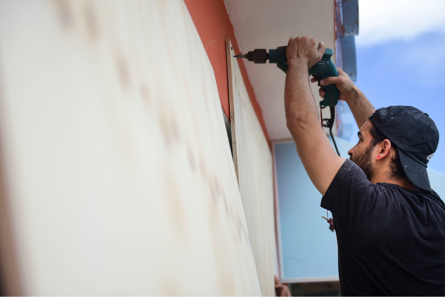 Cyber School Supply employee Christopher Rodriguez installs wood panels on windows in preparation in preparation for Hurricane Irma, in Carolina, Puerto Rico, Tuesday, Sept. 5, 2017. Irma grew into a dangerous Category 5 storm, the most powerful seen in the Atlantic in over a decade, and roared toward islands in the northeast Caribbean Tuesday. (AP Photo/Carlos Giusti)