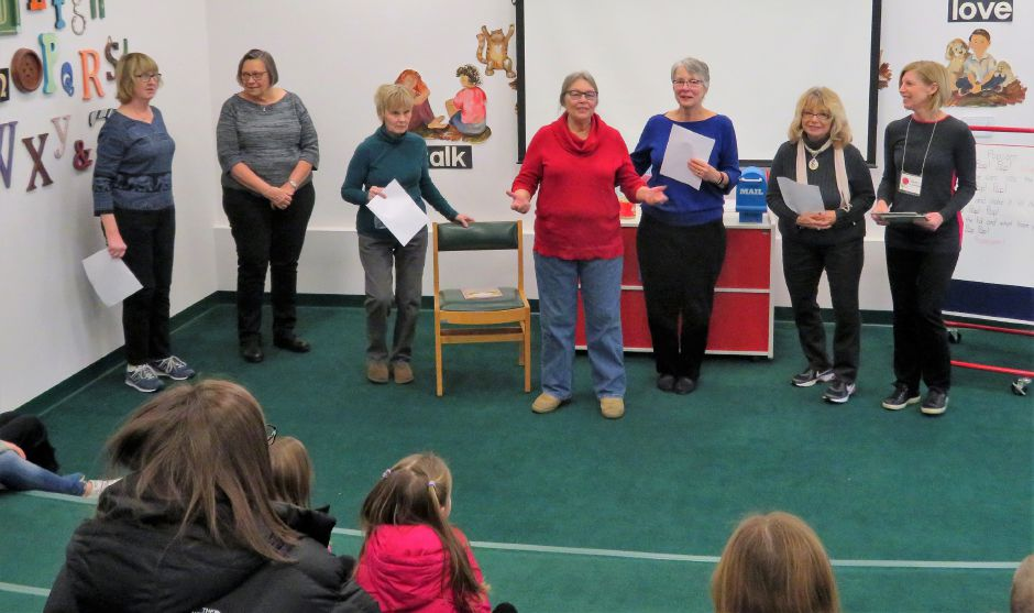 The Wallingford Garden Club Youth Committee talking to the children about why and how popcorn pops. Left to right are Christine Salisbury, Kathy Bryson, Priscilla Perrin, Sue Hillinski, Deb Tagliatela, Dina Rawling and Sue Laursen.