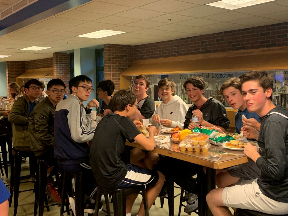 Students from Coginchaug and Tongji high school broke bread at a community potluck dinner on Tuesday, Oct. 1.Photo by Everett Bishop, Town Times
