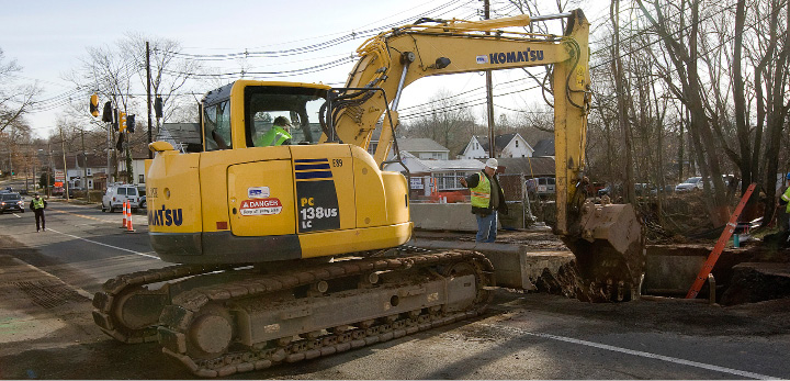 Workers for New Haven based C.J. Fucci Inc. continue work on the East Center Street bridge replacement project near Vinny