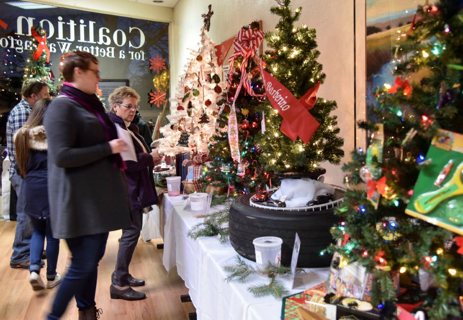 Strollers enjoy free refreshments and enter to win decorated Christmas trees at the Coalition for a Better Wallingford during the 9th annual Holiday Stroll in downtown Wallingford on Friday, Dec. 1, 2017. | Bailey Wright, Record-Journal
