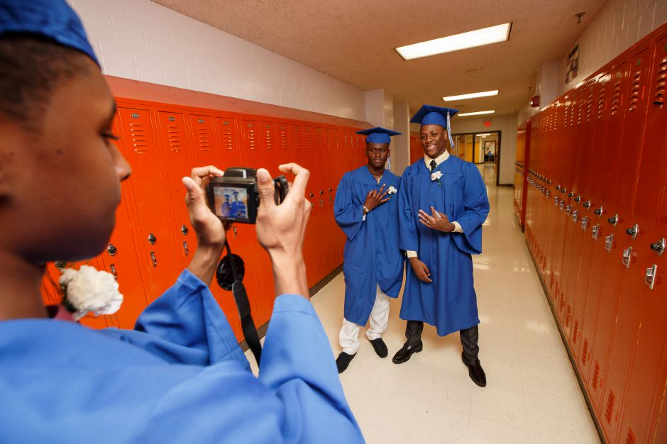 Derrick Payne takes a photo of classmates Quindran Quintin-Cole left and Treyquan Parks Thursday during Southington High School Graduation ceremonies at Southington High School in Southington June 21, 2018 | Justin Weekes / Special to the Record-Journal