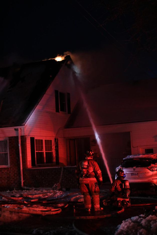 Firefighters responded to a house fire on Cedar Street in Wallingford Monday evening. | Devin Leith-Yessian, Record-Journal