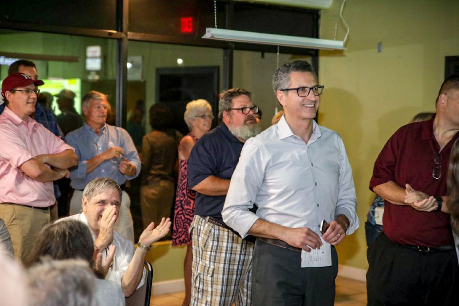 Former Meriden Mayor Manny Santos smiles as election results show him with a growing lead Tuesday night Aug. 14, 2018. | Devin Leith-Yessian, Record-Journal
