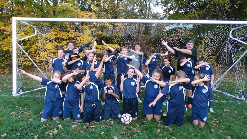 An enthusiastic team dab for SJS soccer.