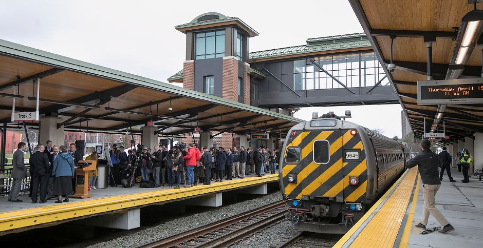 Am Amtrak train pulls out of the Meriden train station, Thursday, April 19, 2018. State and city leaders crowded onto the platform at the new Meriden train station to cut the ribbon on the CTrail Hartford Line, which officials hope will provide an alternative option for commuters and potentially ease highway congestion. Dave Zajac, Record-Journal