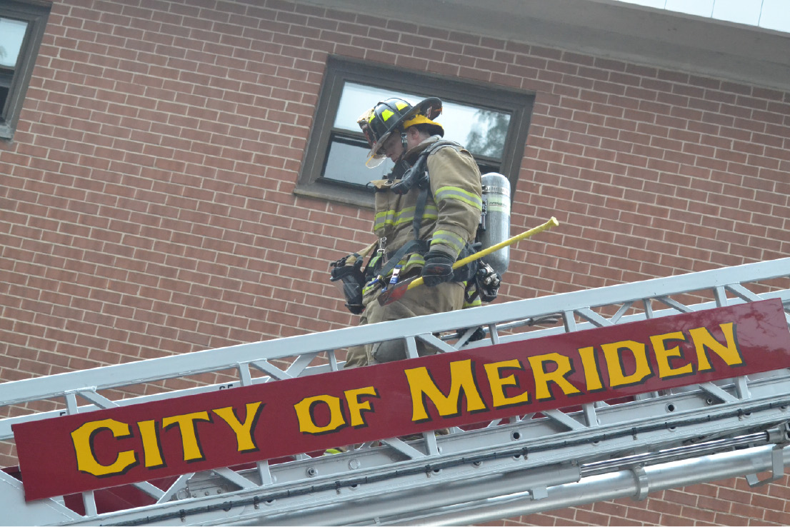 FILE PHOTO - Members of the Meriden Fire Department help out during the training session at the Mills Memorial Apartments on Wednesday, Sept. 7, 2016. | Pete Paguaga, Record-Journal