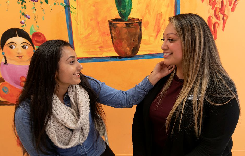 Michelle Orozco, 17, left, and Adriana Rodriguez, interim director at Spanish Community of Wallingford, reenact a photo taken of them 15 years ago at SCOW, Monday, Oct. 15, 2018. Rodriguez has been an inspiration for Orozco over the years. Dave Zajac, Record-Journal