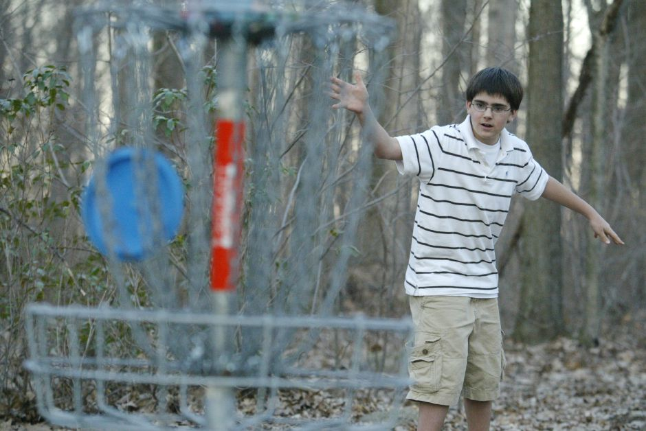 "Panthorn Park ranks seventh on TripAdvisor.com's list of things to do in Southington. In this file photo, Chad Mehmel, 11, watches his disc fall into the ""hole,"" a metal stand that catches the disc, on the 9-hole disc golf course that he helped to construct at Panthorn Park on March 29, 2006."