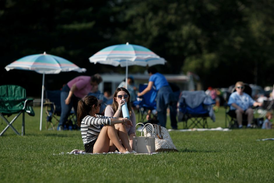 Alissa Como of NY left and Gabby Hummel of Wallingford enjoy a picnic dinner before the fireworks Friday during the 34th Annual Plainville Balloon Festival at Norton Park in Plainville August 24, 2018 | Justin Weekes / Special to the Record-Journal