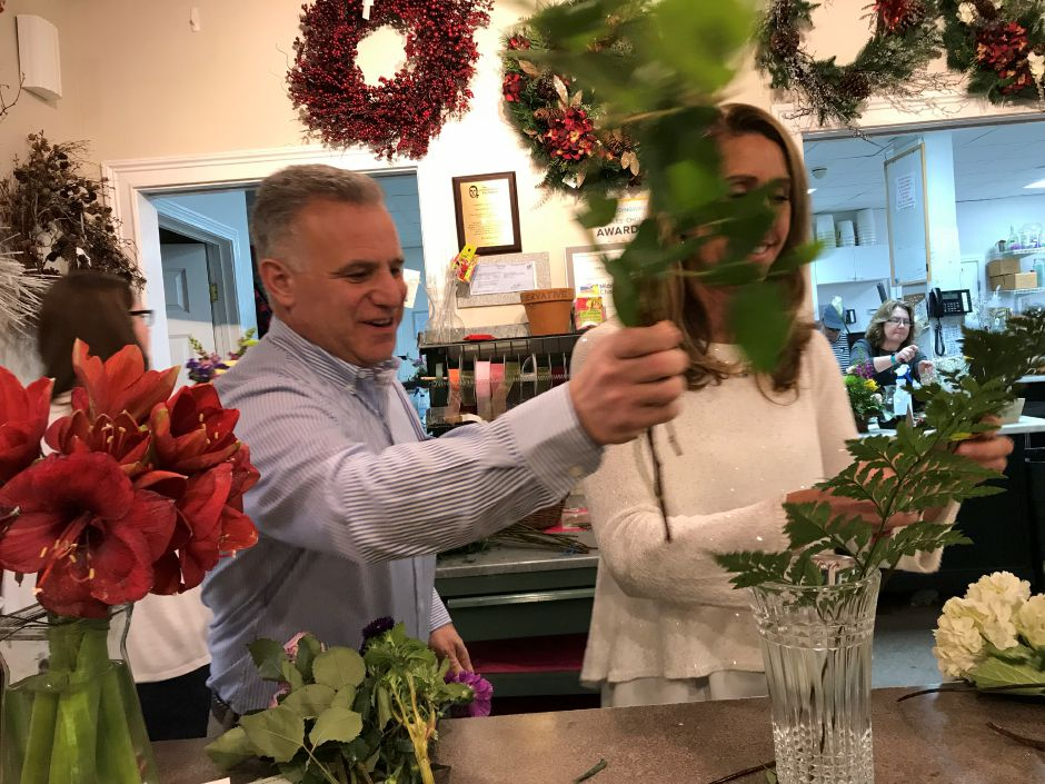 Sebastian Malespini and Sharon Elizabeth Locke put together a floral arrangement at Sharon Elizabeth