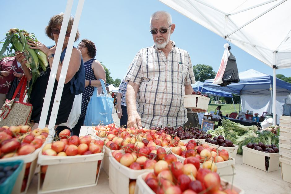 Zane Spiller of Milford finds some cherries Sunday during the Mountainside Market at Powder Ridge Mountain Park and Resort in Middlefield  July 8, 2018 | Justin Weekes / Special to the Record-Journal
