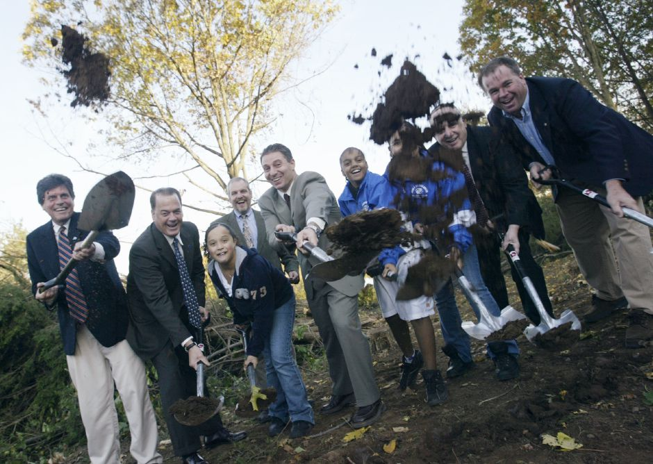 (From left to right) State Representative Emil A. Altobello, State Senator Thomas P. Gaffey, Angelica Espada age 11, State Representative James W. Abrams, Meriden Mayor Mark Benigni, Damika Martinez age 12, Adianis Matias age 11, Meriden Deputy Mayor Matthew C. Dominello and Boys & Girls President Kevin F. Curry share a laugh as they throw divots of ground soil toward the camera during groundbreaking ceremonies for the Laura Cuno Girls Camp at Cuno Camp in Meriden on Thursday Oct., 28,2004.