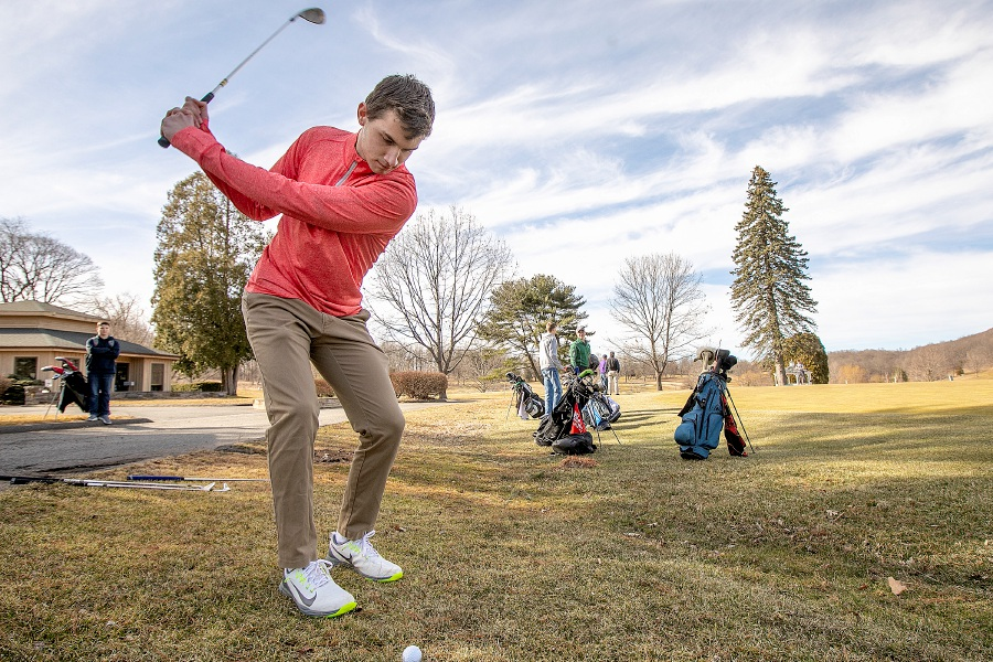 Benjamin Pierce, 17, of Meriden, pitches up to the practice green at Hunter Golf Club in Meriden, Mon., Mar. 25, 2019. The course opens Wednesday. Dave Zajac, Record-Journal