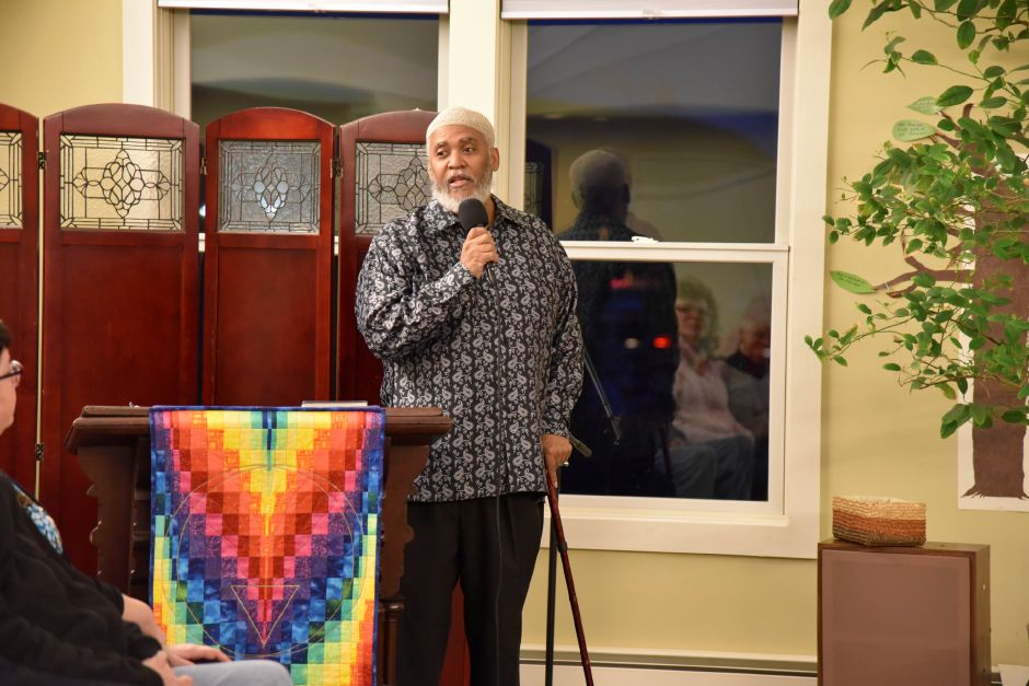 Community members and leaders gathered at the Unitarian Universalist Church to support Indonesian immigrant Sujitno Sajuti, who is facing deportation, on Friday, Feb. 2, 2018. | Bailey Wright, Record-Journal