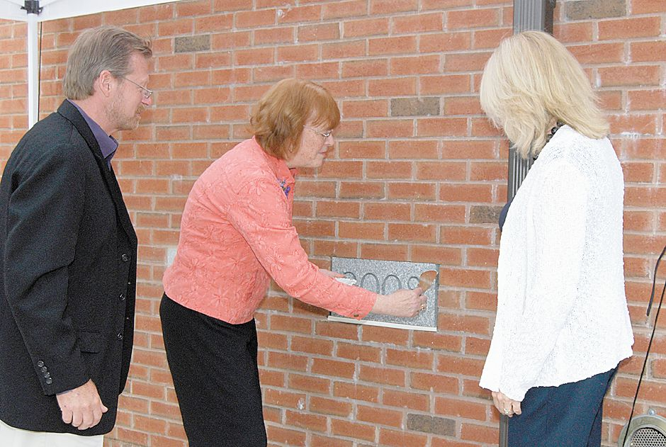 "(From left to right) David Golebiewski of the Building Commitee, Leslie Scherer, Director of the Wallingford Public Library, and Karen Caplan President of the Board of Managers, joined together for the ""Laying of the Cornerstone"" using the same trowel that was also used in 1899 for the first Wallingford Library Building, Saturday May 31, 2008. (Holly Bouchard Smith/for the Record-Journal)"