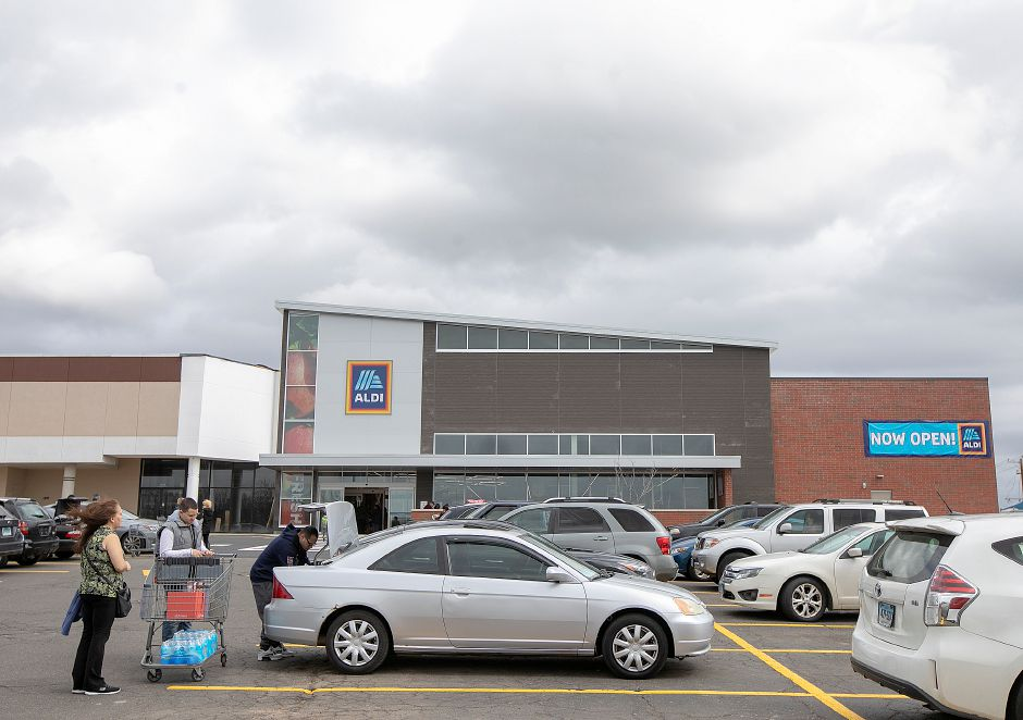 The newly expanded Aldi in Wallingford reopened on Thursday after adding 3,000-square feet and remodeling the interior and facade.