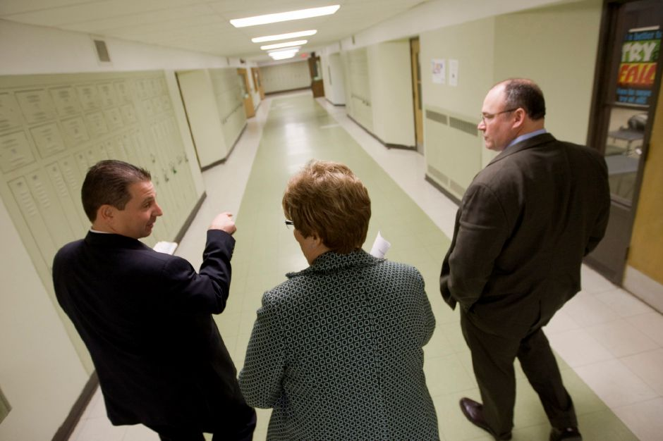 Superintendent Benigni does a walkthrough of Maloney High School with Principal Ann Hushin and Associate School Superintendent Robert Angeli. In between drop-ins, Benigni gives feedback on each class. Benigni also visited Platt High School later in the day. (Dave Zajac/Record-Journal)