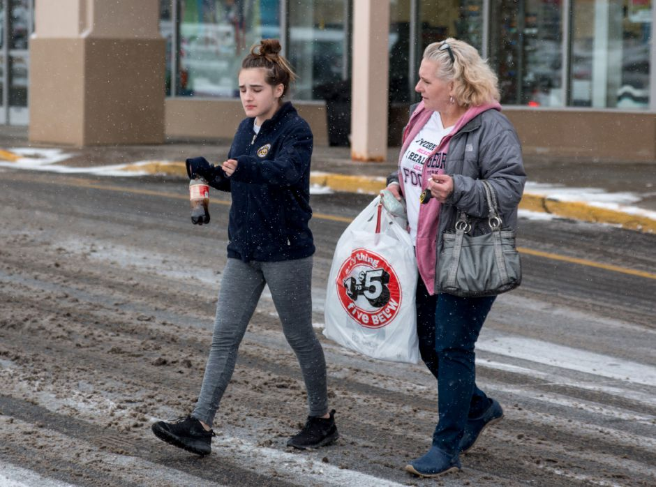 Nichola Mocctio, 13, and Cathie Mocctio walk out of Five Below in Meriden during Saturday