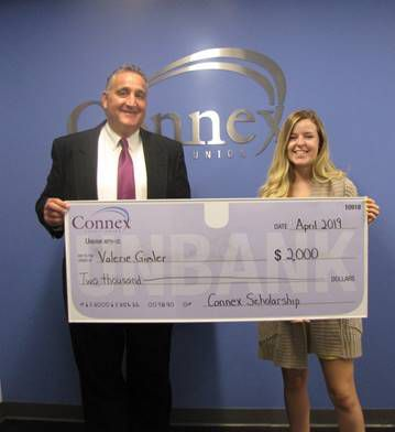 Connex president and chief executive officer Frank Mancini presents Valerie Gimler with the $2,000 John R. Edwards Community Involvement Scholarship.