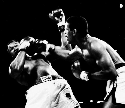 Challenger Michael Spinks is on the attack after Larry Holmes, left, Sept. 21, 1985. Spinks won by unanimous decision. (AP Photo)