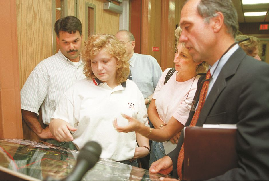 RJ file photo - Area resident Frank Clynes, left, Tricia Belfonti and Michelle Allaire inspect photos with Glenn Almquist, a senior project manager