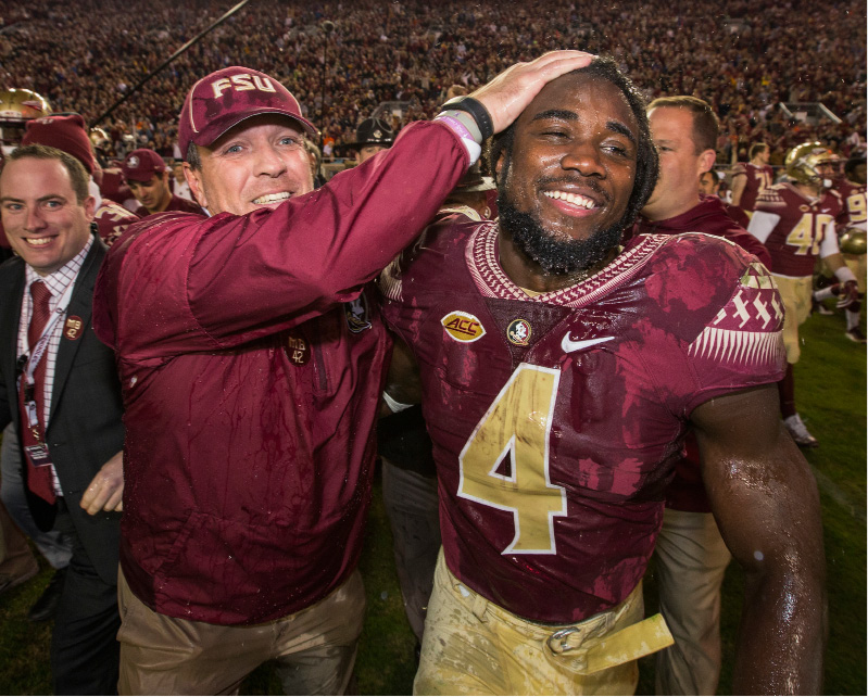 FILE - In this Nov. 26, 2016, file photo, Florida State coach Jimbo Fisher and running back Dalvin Cook celebrate the team