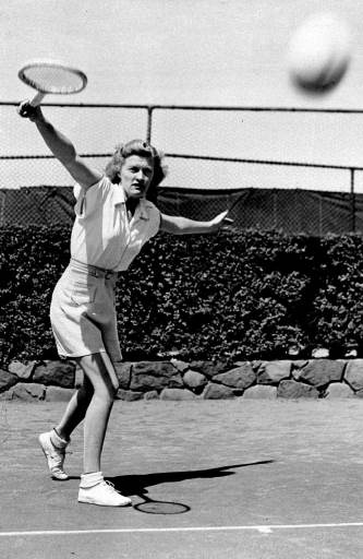 Pauline Betz of Los Angeles, queen of the tennis stars, works out at Forest Hills, N.Y., Aug. 30, 1931 in preparation for the national women
