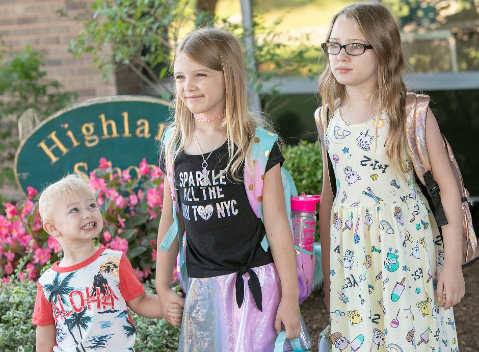 Owen Donovan, 2, smiles up at sisters Sophia, 7, and Jaicee, 9, while posing for photos on the first day of school at Highland Elementary School in Cheshire, Thursday, August 30, 2018. Dave Zajac, Record-Journal