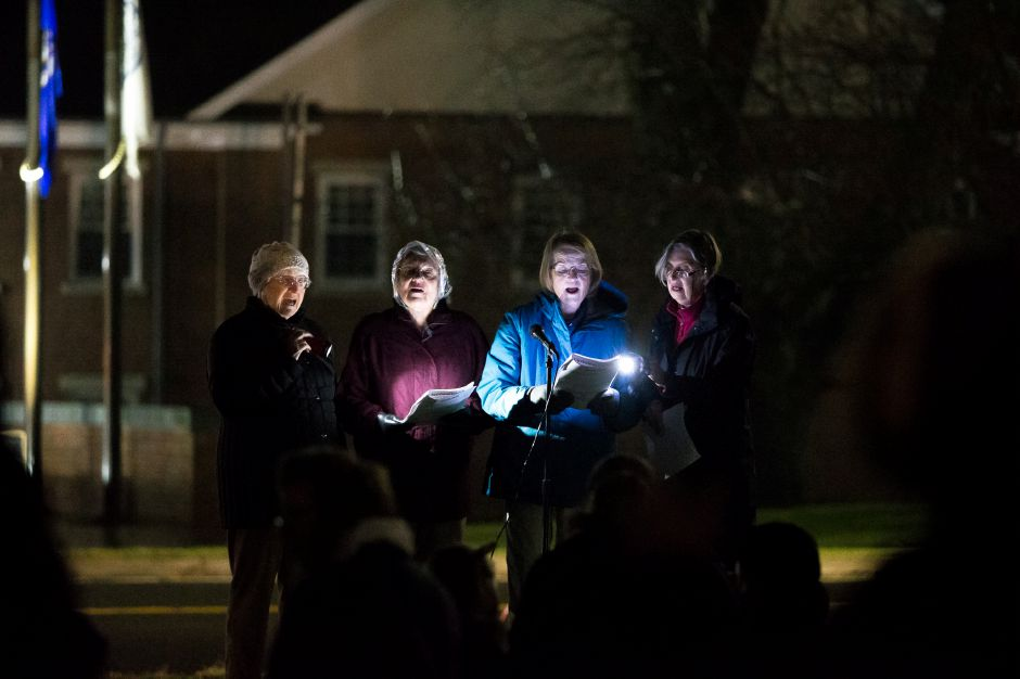 Marianne Eaglesoh left Fran Liedke, Sally Ziegler and Marge Moser of the Cheshire Community Chorus sign carols Sunday during the annual tree lighting at the First Congregational Church in Cheshire December 2, 2018 | Justin Weekes / Special to the Record-Journal