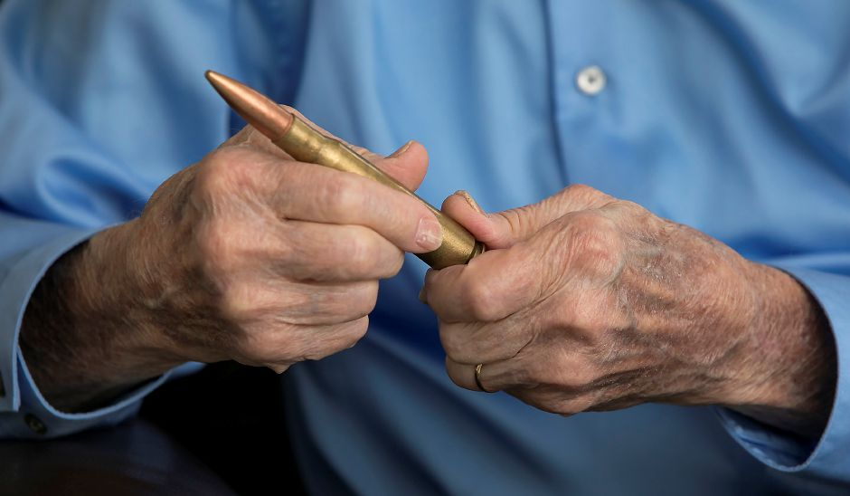 WWII U.S. Army Air Force veteran, Irvin Daubert, of Cheshire, holds a 50 caliber machine gun bullet Thursday, May 17, 2018. Daubert is one of the oldest members of the town's VFW post and was honored by the Town Council earlier this year. Daubert was a gunner on B-24 bombing missions during the war. Dave Zajac, Record-Journal