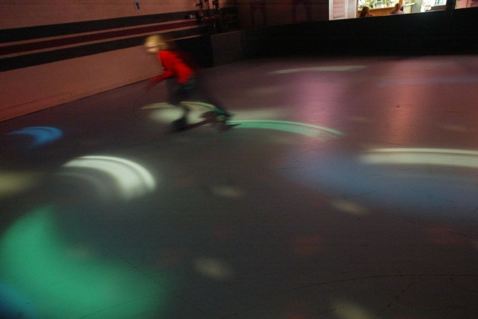 Colorful lights and fast-paced music are still a part of roller skating at Wheel World in Wallingford on January 11, 2004. Wheel World is one of only a handful of remaining roller skating venues in the state.