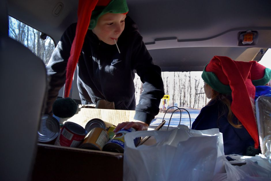 Clayton Wiseman, 12, carries donations to his team