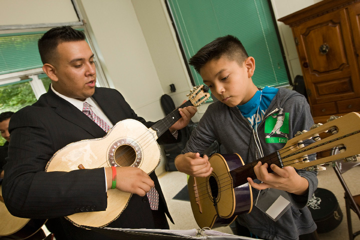 Guitarist Jose Robles, of Las Vegas based Mariachi Mexico Antiguo, instructs Felipe Pacheco, 11, of Wallingford, while visiting the Spanish Community of Wallingford, Monday, July 6, 2015.  |  Dave Zajac / Record-Journal