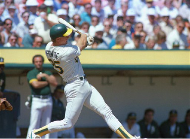 Oakland Athletics? Mark McGwire slugs a three run home run off of Boston Red Sox starter Mike Smithson in the first inning of play on Wednesday, August 31, 1988 in Oakland, Calif. (AP Photo/Eric Risberg)