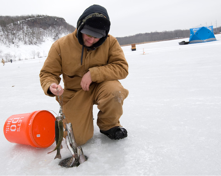 FILE PHOTO -- Jeremy Wood, 16, of Berlin, shows several rainbow and brown trout he and brother, Josh, 13, caught while ice fishing on Black Pond in Middlefield, Monday, February 15, 2016.   |  Dave Zajac / Record-Journal